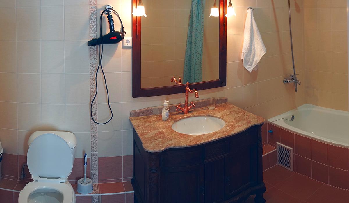 туалет ванная комната в отеле в номере люкс